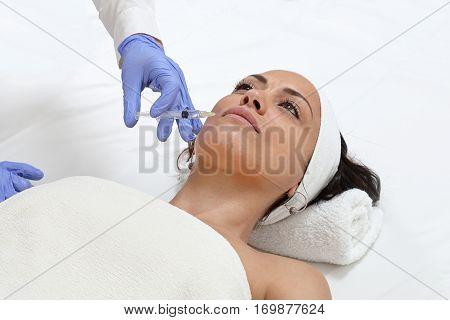Young Woman Having Lips Augmentation at Beauty Clinic