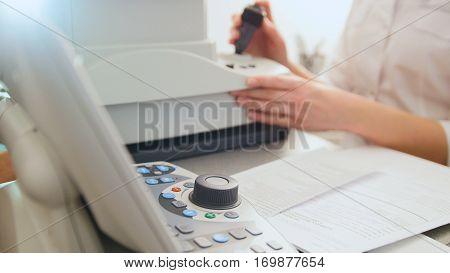 Optometrist equipment in use - generic eye scanner machine, close up