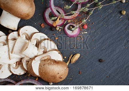 Button mushroom with rosemary onion and peppercorns. Still life food background. Healthy food.