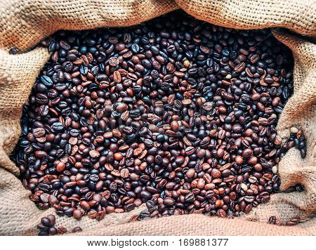 Coffee concept. Sac with roasted coffee beans