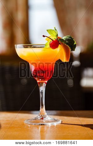 tropical summer fruity coctail with cherry and orange