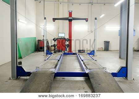 Wheel alignment equipment in a car repair station