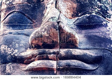 Buddha face. Stone murals and sculptures in Angkor wat Cambodia. Buddhism concept.