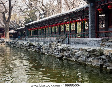 Beijing, China - March 26, 2015: Long covered walkway in classical Chinese garden of Prince Gong palace