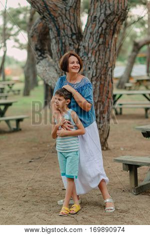 nice conversation with my mother's boy in the park under a tree