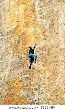 The rock-climber during rock conquest. Active sport concept