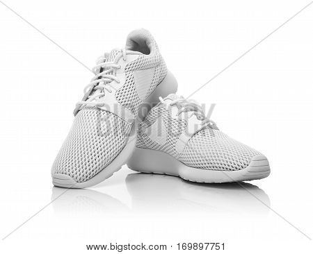 White unbranded sneakers isolated on white background.