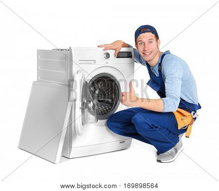 Plumber with washing machine on white background