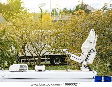 Satellite antenna dish on Tv televison truck live transmission - Tv Televison Truck reporting live the official event