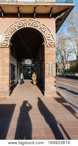 MULHOUSE FRANCE - DEC 12 2016: Start of the beautiful colonnades Arcades on the Avenue du Marechal Foch in central Mulhouse on a warm winter sunny day