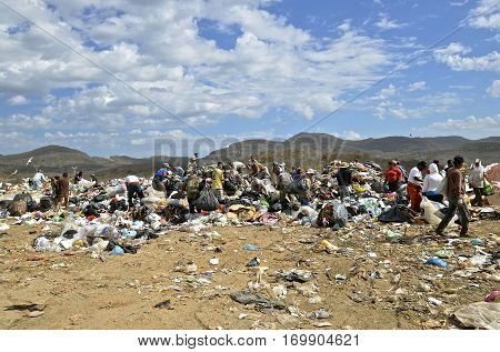 MAZATLAN, JANUARY 30, 2017: Dump Dwellers sift through the garbage, debris, and refuse of a landfill in the Mazatlan city dump.