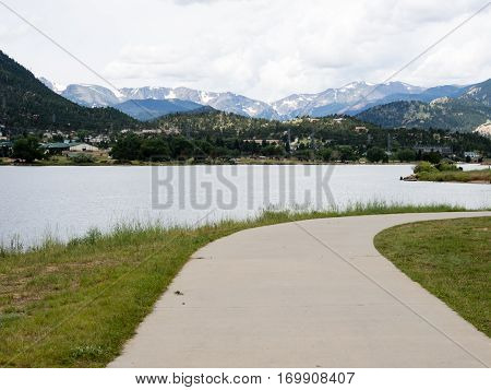 Walkway along Lake Estes waterfront city of Estes Park, Colorado