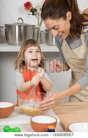 Child Whipping To Make A Cake With Mother