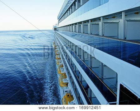 Large cruise ship with balconies at sea