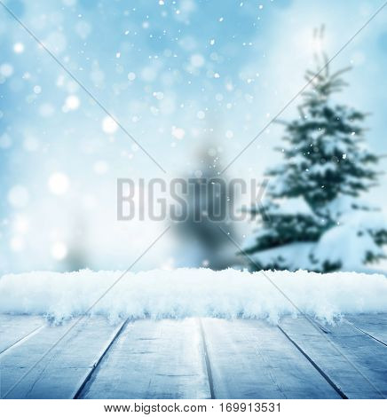 Happy New Year greeting background with table .Winter landscape with snow and Christmas trees
