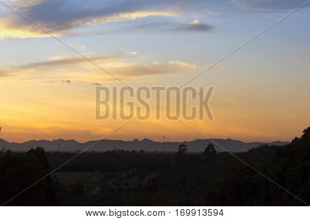 Moutain silhouette and sunset Or Hill in the evening light.Dark tone