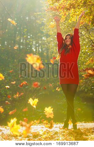 Girl Tossing Up Leaves.