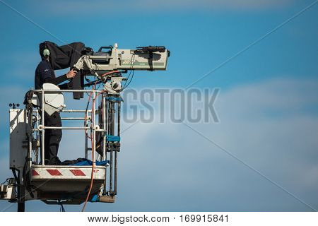 VALENCIA, SPAIN - NOV 13: TV camera operator during Motogp Grand Prix of the Comunidad Valencia on November 13, 2016 in Valencia, Spain.