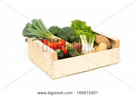Cut Out Of Wooden Crate Filled With Assorted Fresh Vegetables