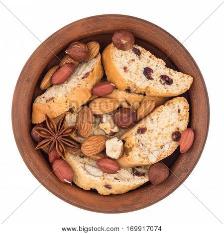 Cookies with raisins and nuts in a ceramic plate. Isolated on white background. Top view.