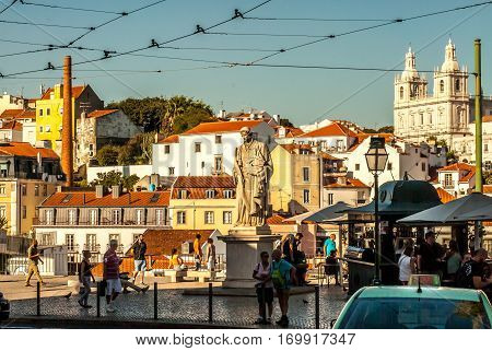 Lisbon, Portugal - Septmember 19, 2016: Streets and views around viewpoint of Santa Luzia busy with tourists enjoying the beautiful scenery