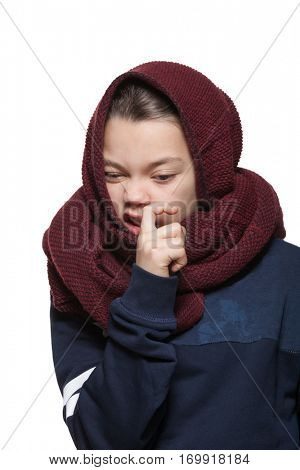 Girl with scarf on head  does a grimace, portrait in studio