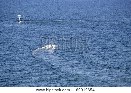 people ride jetski with high speed on blue sea at Hua HIn Thailand with copy space