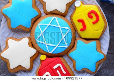 Plate with tasty cookies for Hanukkah, closeup