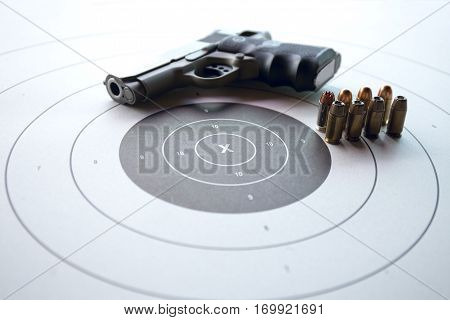gun shooting target with pistol and bullet and copy space