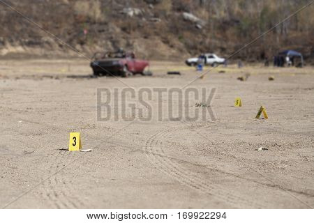 evidence marker and blurred wrecked car with law enforcement background in post blast investigation training with copy space
