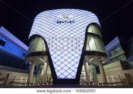 DUBAI UAE - DEC 5 2016: Bentley dealership in Dubai - Al Habtoor Motors illuminated at night. Dubai United Arab Emirates