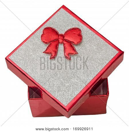 Red gift box with shinny silver cover and red bow close up isolated