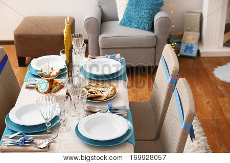 Table served for Hanukkah in living room