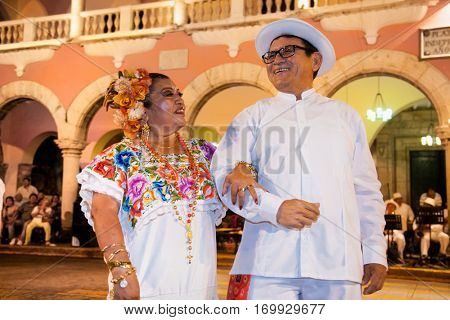 MERIDA, MEXICO-DEC 14, 2015: A lady celebrating Day of the Virgin of Guadalupe (Dia de la Virgen de Guadalupe) on Dec 14, 2015 . Merida, Mexico. It is a popular Catholic feastival