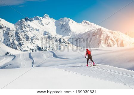 Cross-country skiing classic technique practiced by man in a beautiful panoramic trail