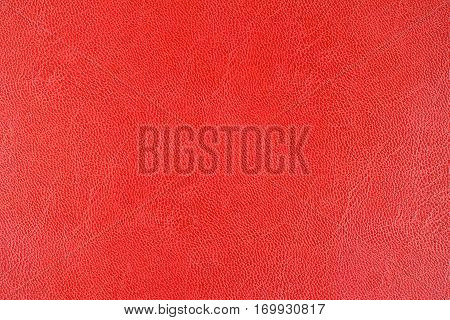 Red leather texture background close up view