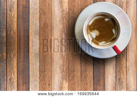 Hot cappuchino copy space on top view wood background