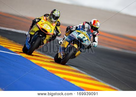 VALENCIA, SPAIN - NOV 13: 27 Lecuona, 57 Pons in Moto2 Race during Motogp Grand Prix of the Comunidad Valencia on November 13, 2016 in Valencia, Spain.