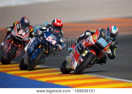 VALENCIA, SPAIN - NOV 13: 23 Schrotter, 54 Pasini, 94 Folger in Moto2 Race during Motogp Grand Prix of the Comunidad Valencia on November 13, 2016 in Valencia, Spain.
