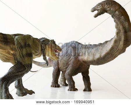 An Herbivorous Apatosaurus Stalked by a Carnivorous Tyrannosaurus Rex