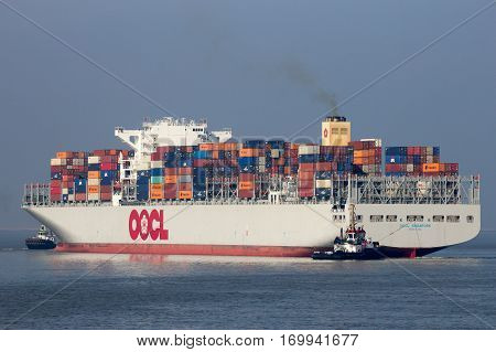 ANTWERP BELGIUM - MAR 12 2016: Container ship OOCL Singapore leaving a container terminal in the Port of Antwerp.