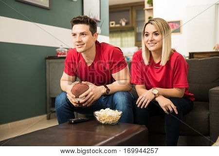 Cute Couple Watching A Football Game