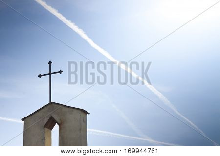 Christian cross in blue background whit copy space - concept image
