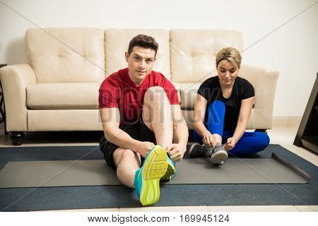 Couple Getting Ready To Workout At Home