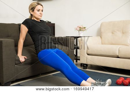 Attractive Young Woman Exercising At Home