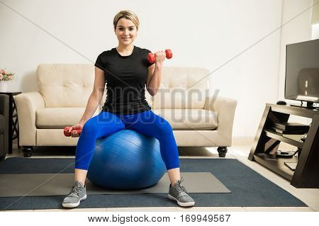 Cute Girl Lifting Dumbbells At Home