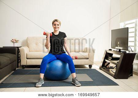 Cute Hispanic Woman Exercising At Home