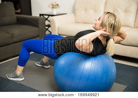 Woman Doing Crunches On A Stability Ball