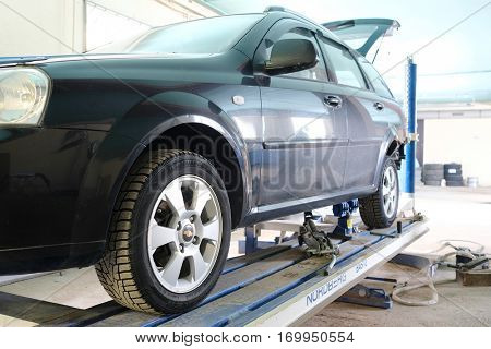Moscow, Russia, December, 8, 2016: Black crashed car on stocks in a car repair station
