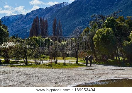 Couple Walking In Puelo National Park